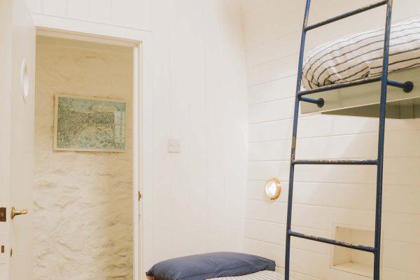 Bunk room with door in the background in Upper Saltings St Ives