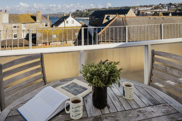 Rear balcony and table of 22 Piazza overlooking rooftops towards Porthminster beach