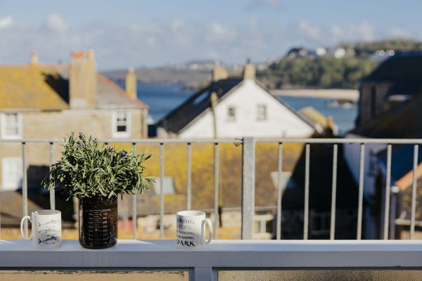 Rear balcony of 22 Piazza overlooking rooftops to Porthminster beach