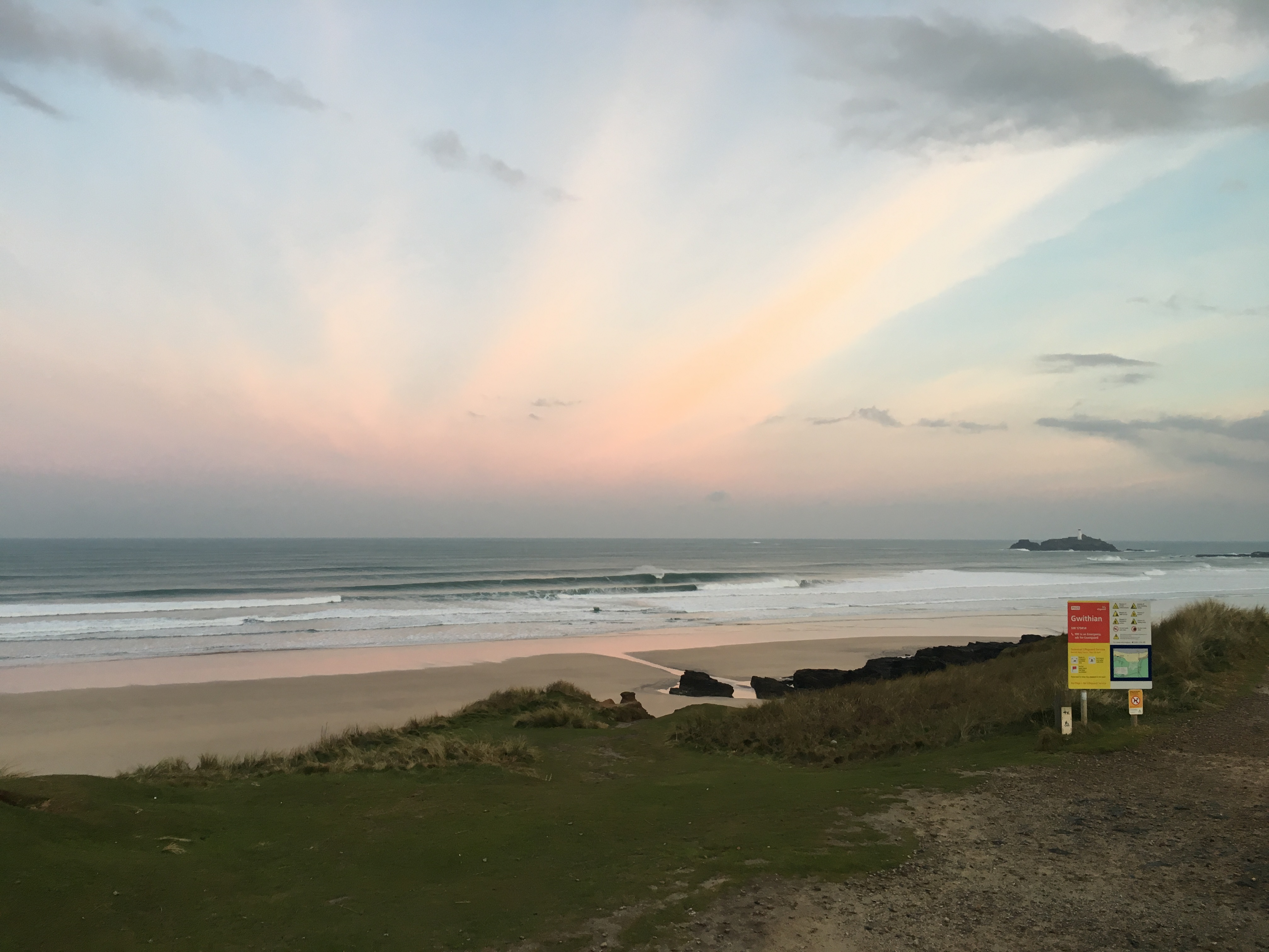 Gwithian early morning surf with pink streaks in the sky